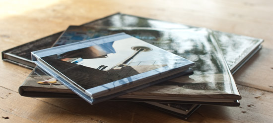 Pile of Hard Bound Custom Wedding Coffee Table Books: 10x10, 8x8 and 5x5
