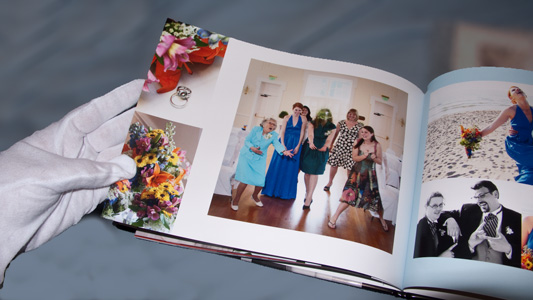 custom wedding book receiving white glove inspection