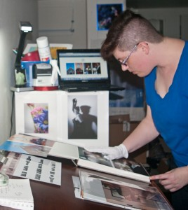 Jane installing prints into a finao element - a la carte full service album design