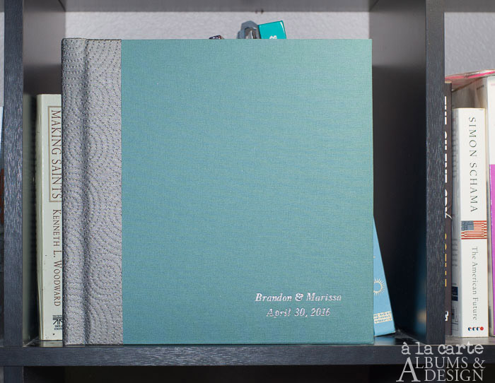 flush album in teal linen with sterling cirque spine, silver imprinting and page gilding, italic